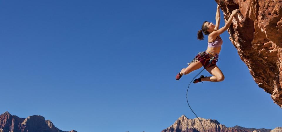 Lady climbing rock, IRIS Free Trial banner